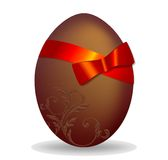 Chocolate egg. Decorated with red ribbon and bow, in vector Royalty Free Stock Photography