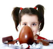 Chocolate egg. Little girl looking at a big chocolate egg Stock Photography