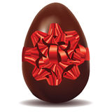 Chocolate Egg with Bow Royalty Free Stock Photography
