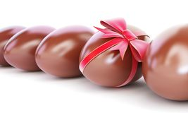 Chocolate egg with bow. On a white background Royalty Free Stock Image
