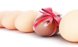 Chocolate egg with bow. On a white background Royalty Free Stock Photo