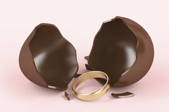 Chocolate egg and engagement ring Stock Photos
