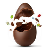 Chocolate egg exploded. On a white background Royalty Free Stock Photography