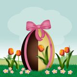 Chocolate egg in the field of tulips. Illustration of chocolate egg in the field of tulips Stock Photo