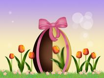 Chocolate egg in the field of tulips. Illustration of chocolate egg in the field of tulips Stock Photography