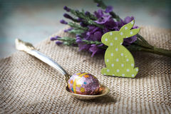 Chocolate egg and a green bunny, Easter. Close up of a chocolate egg and a green bunny, Easter Royalty Free Stock Photography