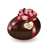 Chocolate egg with greeting card Stock Image