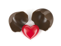 Chocolate egg and heart. Broken chocolate egg with red heart inside Royalty Free Stock Photos
