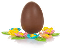 Chocolate egg with marzipan flowers Royalty Free Stock Image