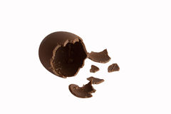 Chocolate egg. An egg with milk chocolate broken Royalty Free Stock Photos