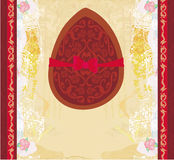 Chocolate egg with red bow Stock Images