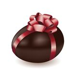 Chocolate egg with red bow Royalty Free Stock Photos