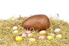 Chocolate egg in straw Stock Photo