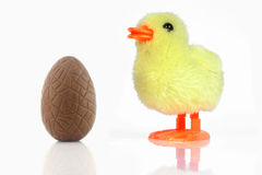 Chocolate egg and toy chicken stock photography