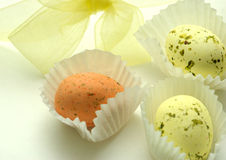 Chocolate Eggs. And yellow ribbon Royalty Free Stock Photos