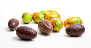 Chocolate eggs. And eggs in foil isolated on white background Royalty Free Stock Photo