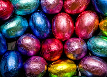 Chocolate eggs. Foil wrapped chocolate eggs background Royalty Free Stock Photos