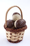 Chocolate eggs basket. Three chocolate eggs in a basket Royalty Free Stock Images