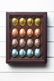 Chocolate eggs in box Stock Images