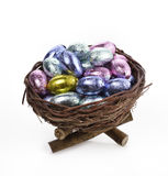 Chocolate Eggs In A Nest. Chocolate Eggs Collection In A Nest On White Background Stock Photography