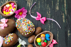 Chocolate eggs covered with colorful sprinkles. Chocolate eggs covered with colorful edible sprinkles Stock Photo