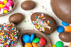 Chocolate eggs covered with colorful sprinkles. Chocolate eggs covered with colorful edible sprinkles Stock Images