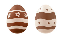 Chocolate eggs decorated - waves, dots, flowers. Royalty Free Stock Images