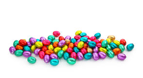 Chocolate eggs in foil stock image