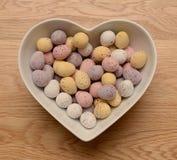 Chocolate eggs heart shaped bowl stock photo