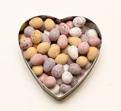 Chocolate eggs heart shaped bowl royalty free stock images
