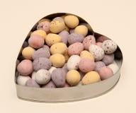 Chocolate eggs heart shaped bowl royalty free stock photos