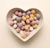 Chocolate eggs heart shaped bowl Stock Photography