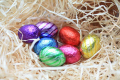 Chocolate eggs in a nest Royalty Free Stock Images