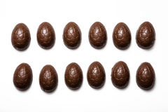 Chocolate eggs. One half of many chocolate eggs in lines on a white background Stock Photo
