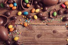 Chocolate Eggs Over Wooden Background Royalty Free Stock Image