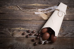 Chocolate Eggs Over Wooden Background Stock Photos