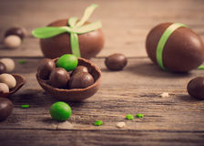 Chocolate Eggs Over Wooden Background Royalty Free Stock Photos