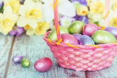 Chocolate eggs in a pink Easter basket Royalty Free Stock Photo