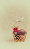 Chocolate eggs in a wicker basket Stock Photography