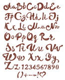 Chocolate English alphabet. Brown handwritten letters and numbers on white background Stock Photo