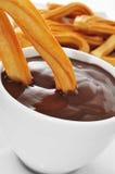 Chocolate español de la estafa de los churros Fotografía de archivo libre de regalías