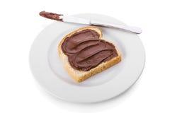 Chocolate espalhado sobre uma fatia de pão Foto de Stock Royalty Free