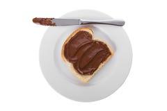 Chocolate espalhado sobre uma fatia de pão Imagem de Stock Royalty Free