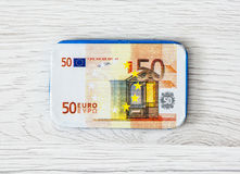 Chocolate 50-euro banknote on the wooden background Stock Photos