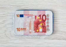 Chocolate 10-euro banknote on the wooden background. European currency. Nominal value. Symbolic sweet food Stock Image