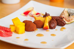 Chocolate and exotic fruits Royalty Free Stock Photos