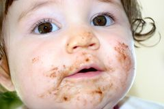 Chocolate Face 2. Baby Girl's face covered with yummie chocolate royalty free stock image