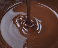 Chocolate falling from above Royalty Free Stock Photography