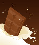 Chocolate falling in milk Royalty Free Stock Photo