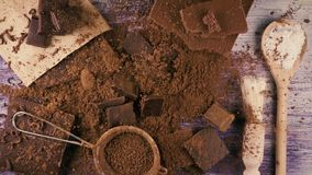 Chocolate falls down on cocoa powder. Slow mo. Top view stock video